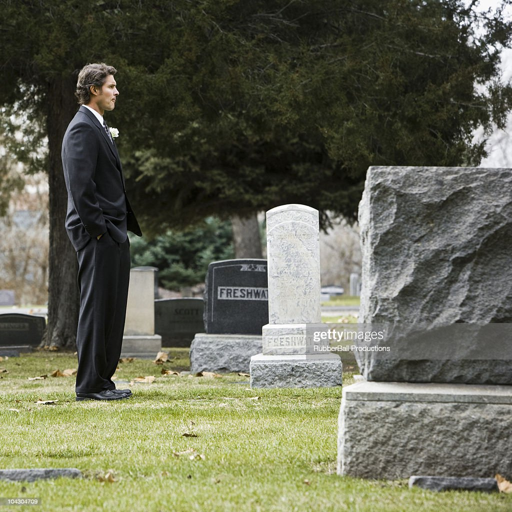 man in a suit at a cemetery