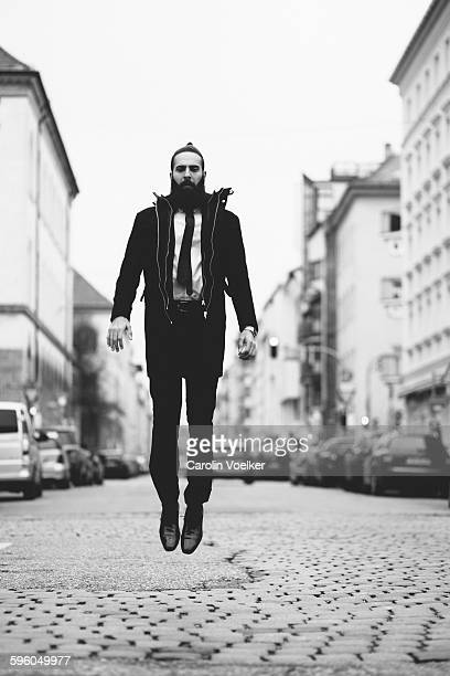 Man in a suit jumping