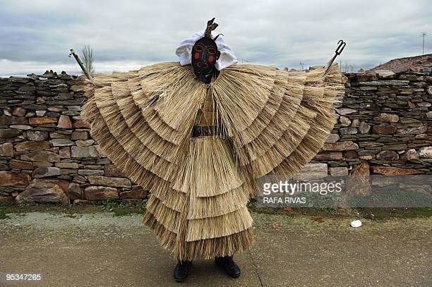 A man in a Tafarron costume poses during this year's San Esteban festivities in the north western Spanish village of Pozuelo de Tabara Zamora...