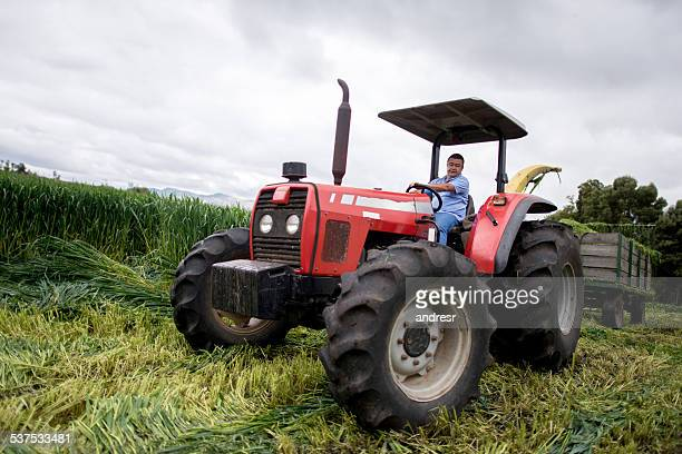 Man in a tractor working at the farm