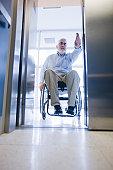 Man in a wheelchair entering an elevator