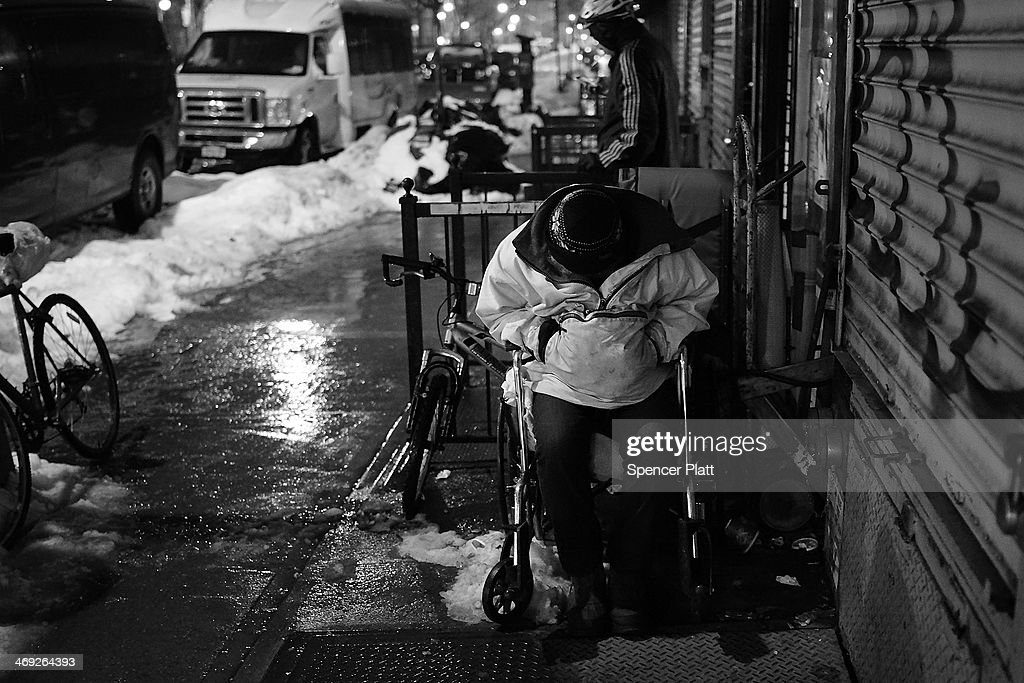A man in a wheelchair waits in the snow and rain on February 13, 2014 in New York City. In what is turning out to be one of the snowiest winter's in recent memory for New York City and much of the East Coast, Thursday's weather is expected to bring a wintery mix of sleet and snow with a total accumulation of over 8 inches of snow before ending early Friday morning.