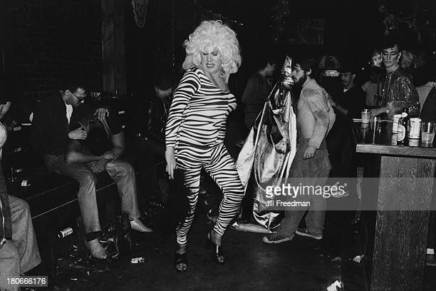 A man in a zebra print body stocking dances in a bar in the West Village New York City circa 1982