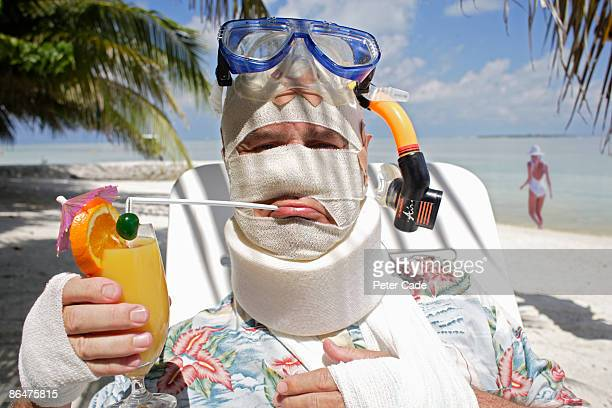 man in bandages on beach