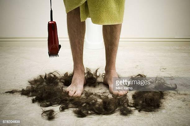 Man in bath towel standing in hair