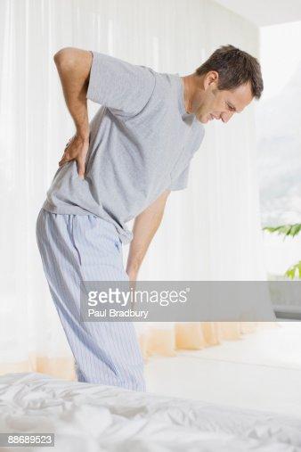Mal di schiena foto e immagini stock getty images - Mal di schiena letto ...