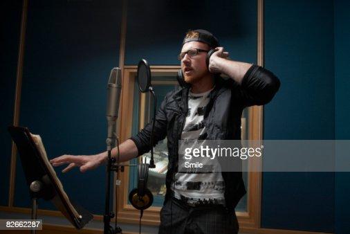 man in black singing in recording studio