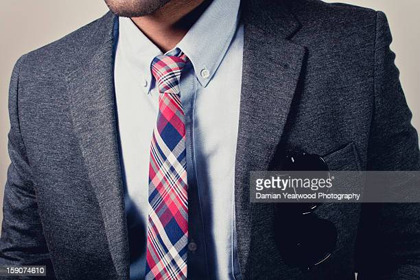 Man in blazer with shirt and tie