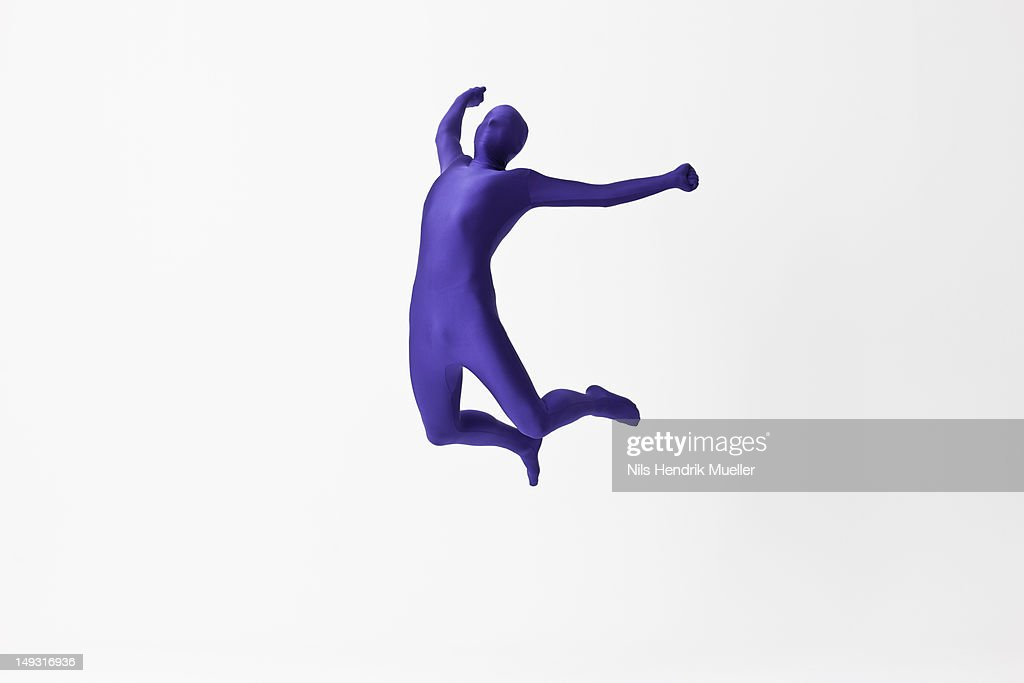 man in bodysuit jumping for joy stock photo getty images