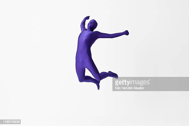 Man in bodysuit jumping for joy