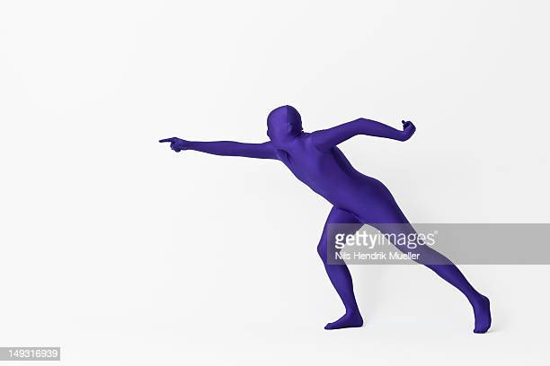 Man in bodysuit pointing