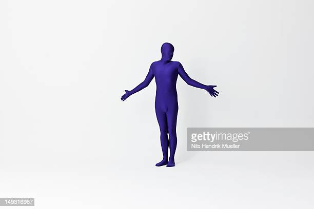 Man in bodysuit shrugging