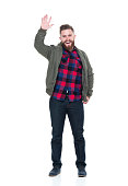 Man in bomber jacket and plaid shirt