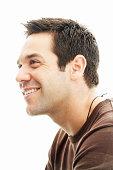 Man in brown shirt smiling, profile