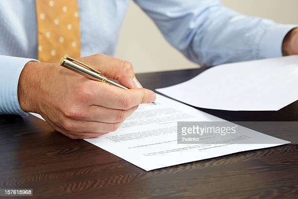 Man in business attire considers signing a contract