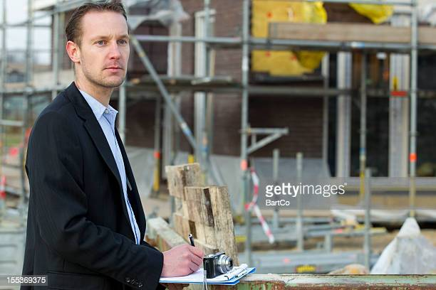 Man in business suit makes quotation for a renovation