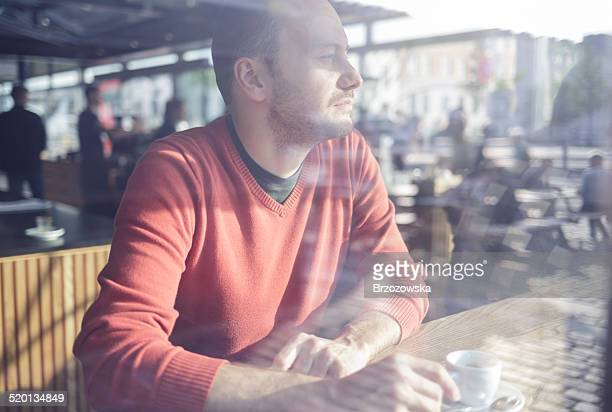 Man in cafe looking through the window (Copenhagen, Denmark)