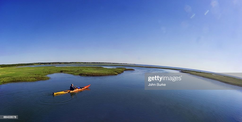 Man in canoe cape cod massachusetts stock photo getty images for Ma fishing license cost