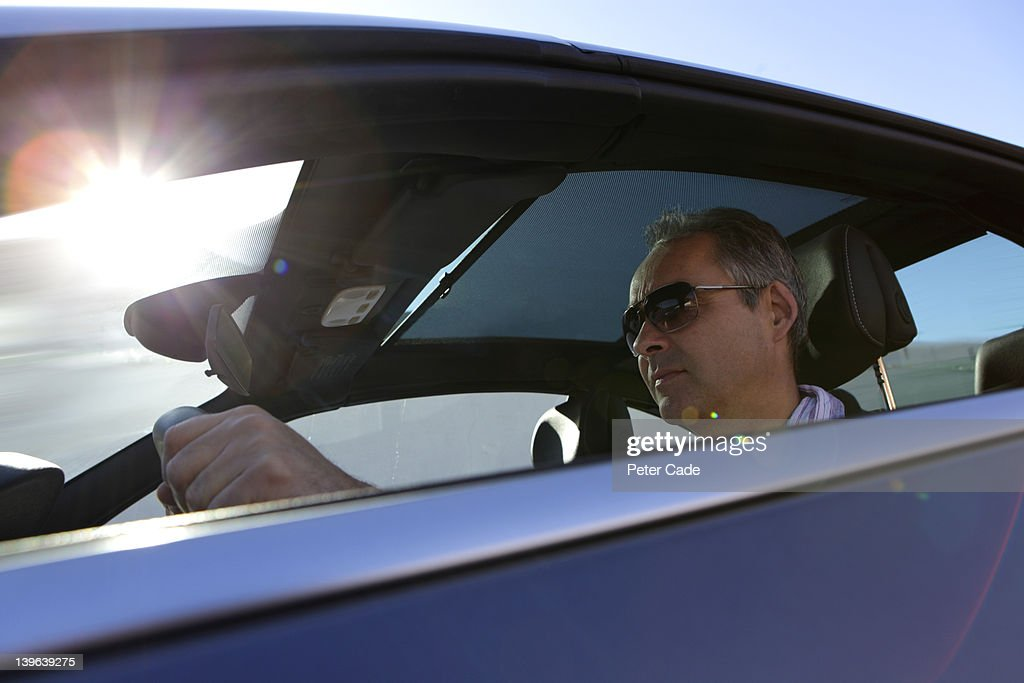 man in car, driving : Stock Photo