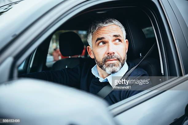 Man in car looking up