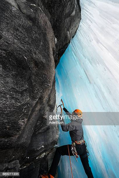 Man in cave ice climbing, Saas Fee, Switzerland