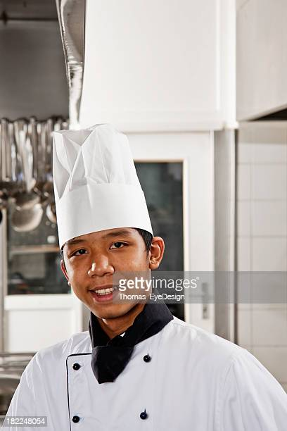 man in chef uniform posing in kitchen