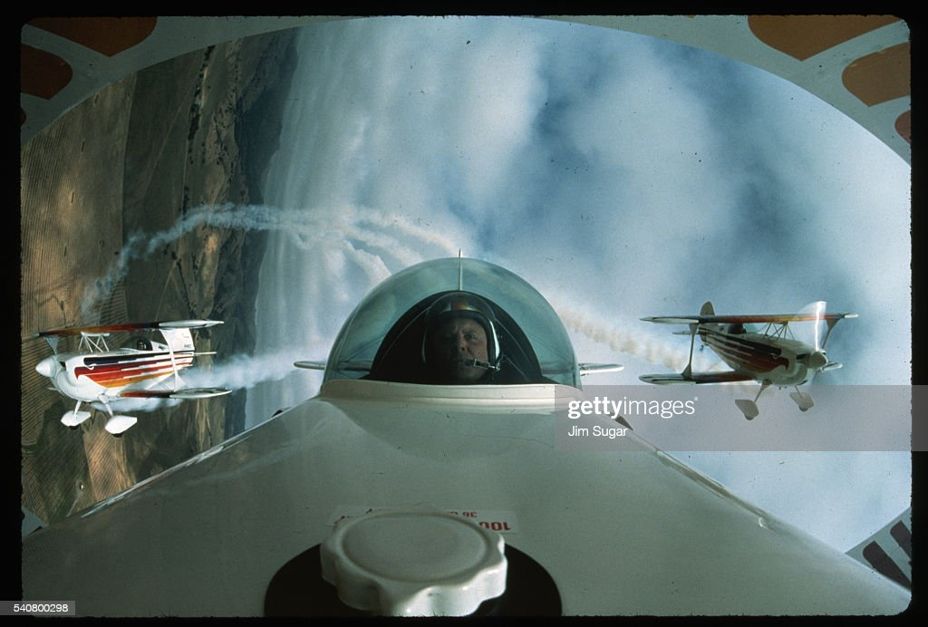 Man in Cockpit with Planes in Background