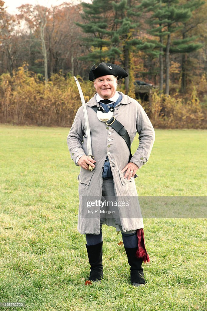 Man in colonial clothes with a sword