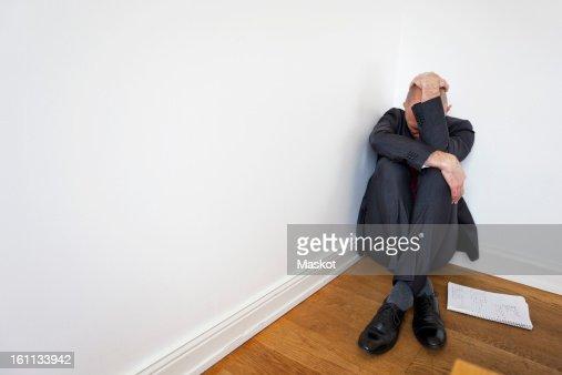 Man in corner : Stock Photo