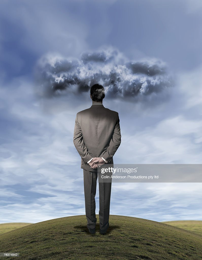 Man in countryside with gloomy sky