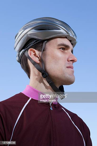 Man in cycling helmet looking into distance