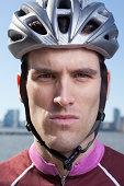 Man in cycling helmet looking straight ahead