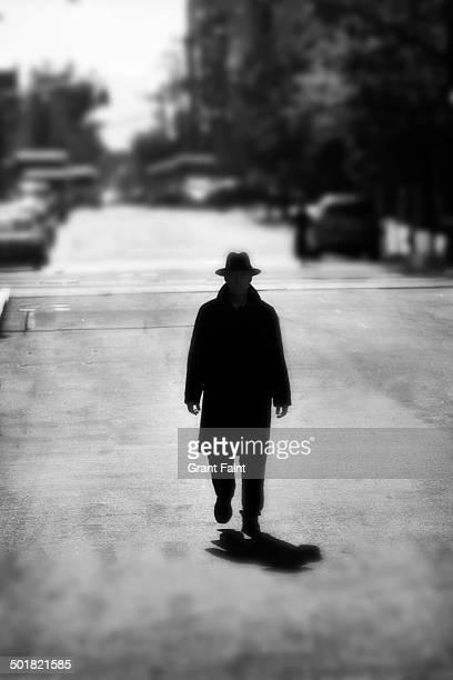 Man in dark hat and coat