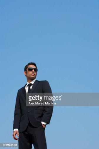 man in dark suit, dark glasses
