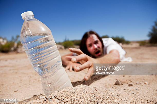 Man in Desert Reaching for Water