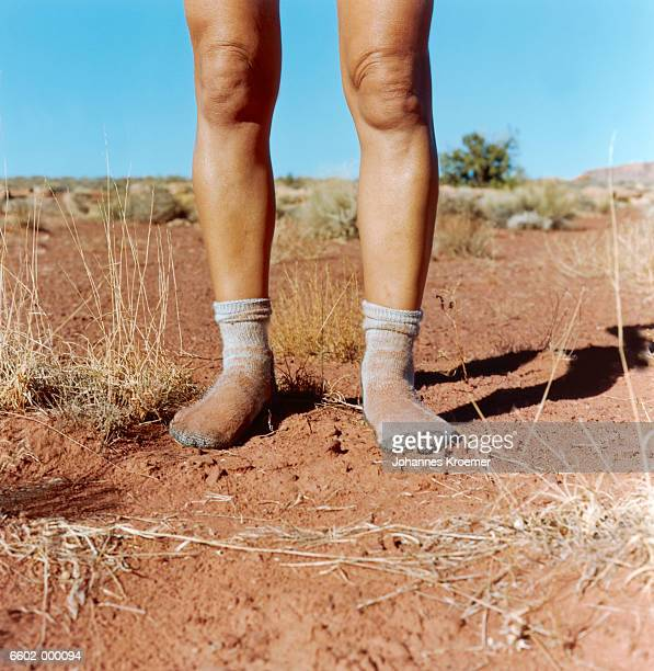 Man in Dirty Socks in Desert