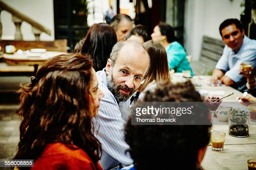 Man in discussion with wife during family dinner
