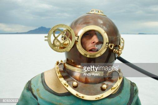 Man in Diving Helmet on Salt Flats. : Stock Photo