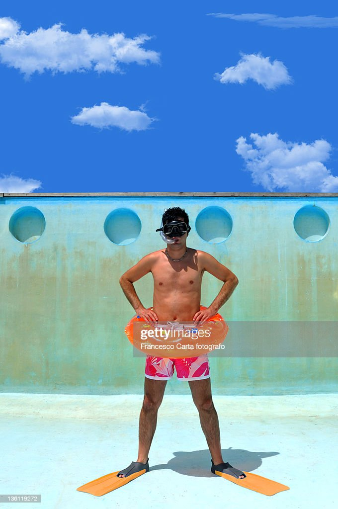 Man in empty swimming pool : Stock Photo