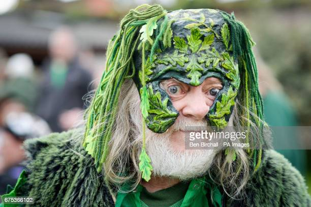 A man in fancy dress at Chalice Well Glastonbury where Beltane festivities are taking place on May Day