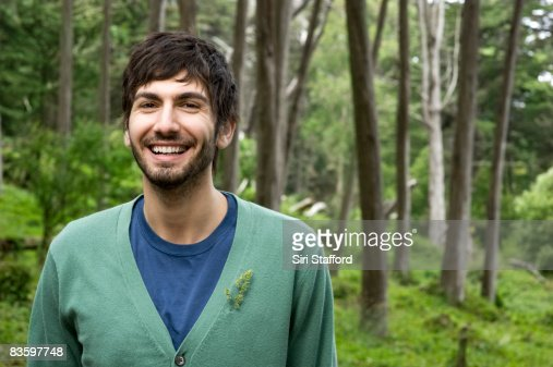 Man in forest, smiling, portrait : Stock Photo