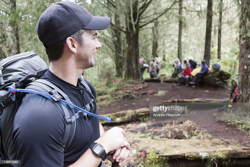 Man in forest with trees covered in Bearded Lichen (usnea barbata) on Lemosho Trail, Mount Kilimanjaro. : Stock Photo