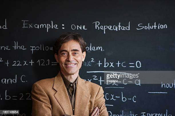 Man in front of blackboard