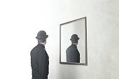 man in front of mirror that reflect his back, surreal magritte concept