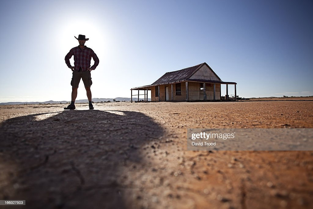 man in front of outback shed