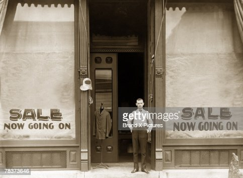 Man in front of store having sale