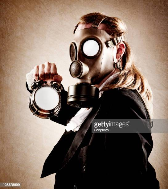 Man in Gas Mask Holding a Clock
