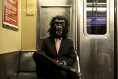 Man in gorilla mask on the train
