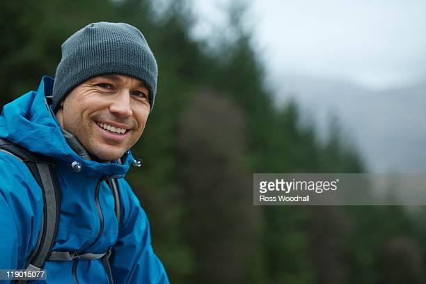 Man in hiking gear on hillside