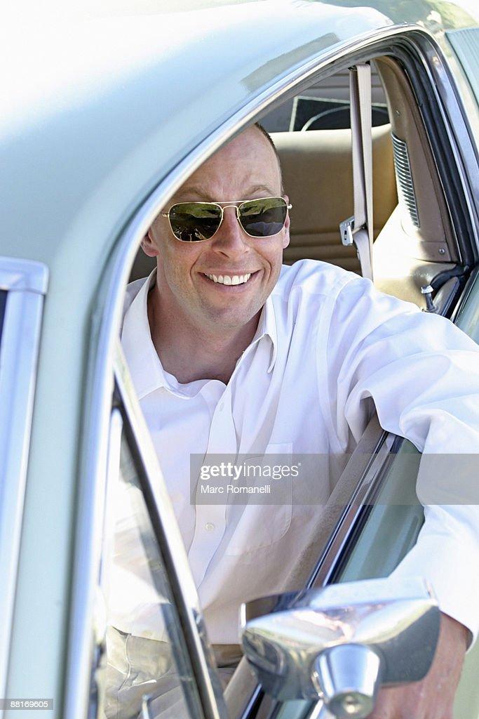 Man in his car